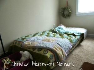 A floor bed is a great addition to a Montessori infant home. ChristianMontessoriNetwork.com