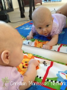 Adding a low mirror to a Montessori infant home is a great way to help your child's development. ChristianMontessoriNetwork.com