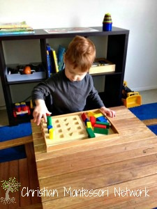 Low shelves and baskets are great for setting up a Montessori infant home. ChristianMontessoriNetwork.com