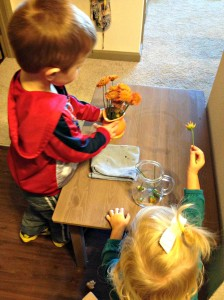 Flower arranging is a fun practical life activity to help kids stay involved in preparing the home for Christmas on ChristianMontessoriNetwork.com