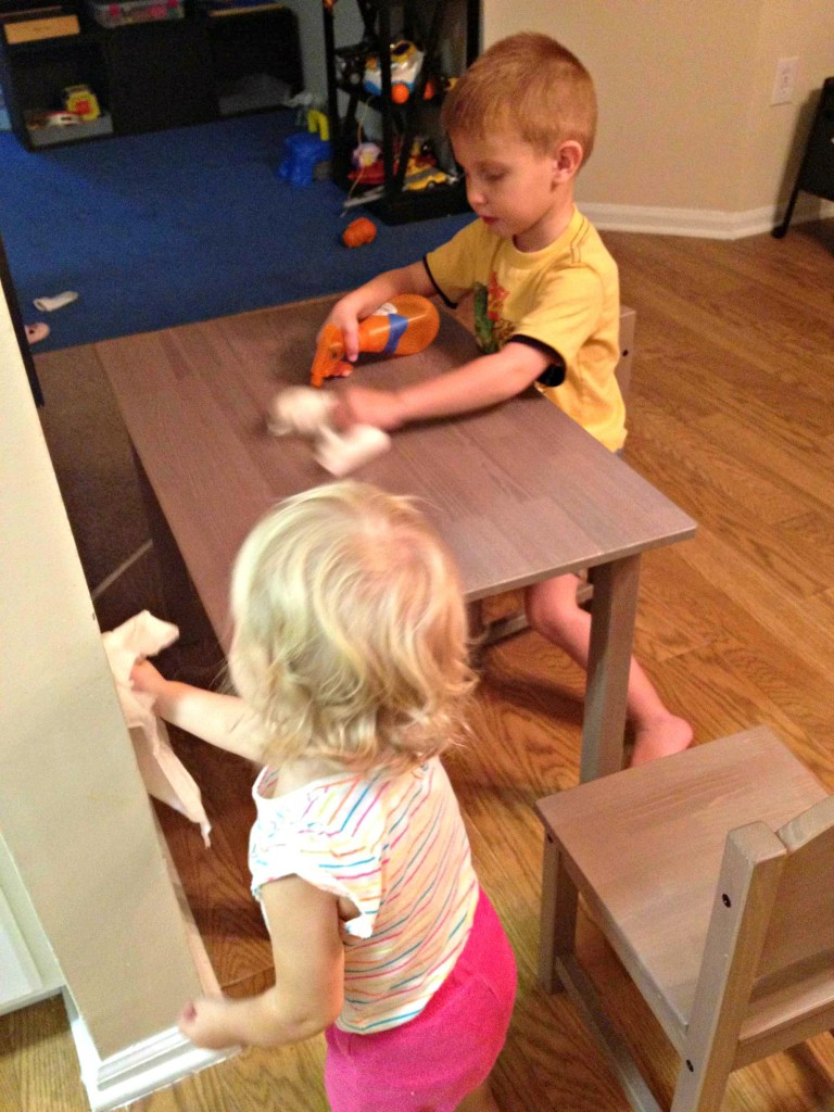 Cleaning a table is a great way to get kids involved in preparing for Christmas on ChristianMontessoriNetwork.com